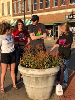 EAST Students Plant Flowers Downtown