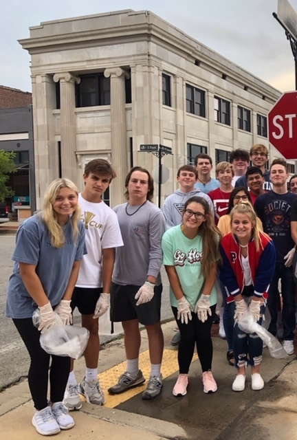 Students cleaning Pruitt Street
