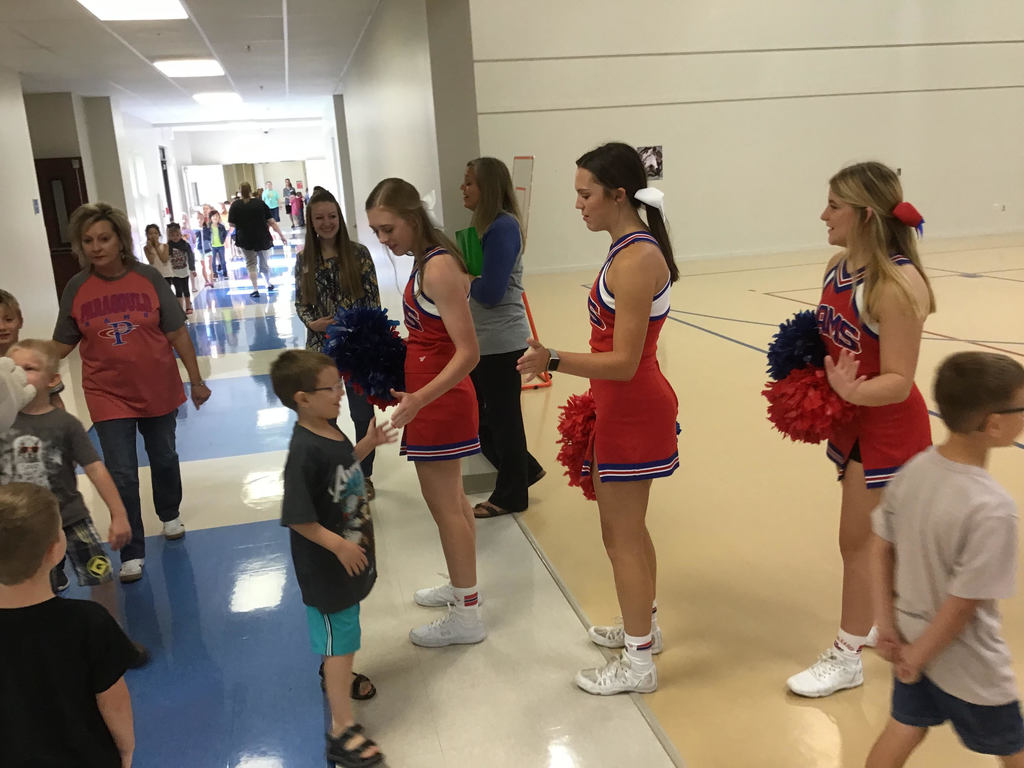 Cheerleaders greeting students