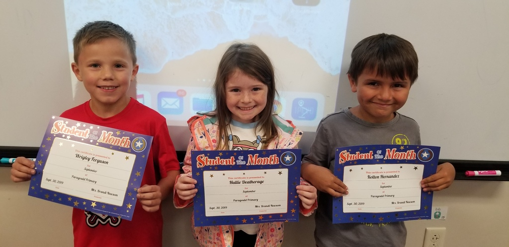Three of Mrs. Hatcher's students holding their certificates