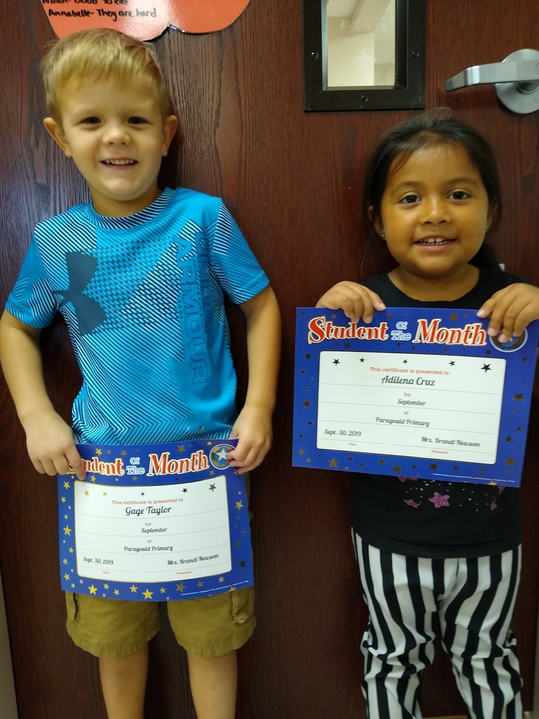 Students of the month with their certificates